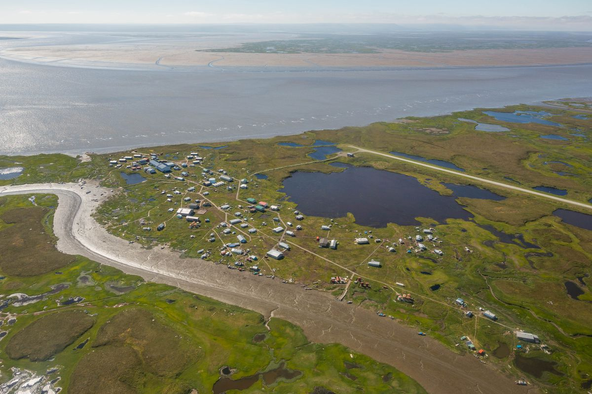 The village of Newtok, in southwest Alaska, on Tuesday, August 4, 2015. The community has lost 3 miles of shoreline to the Ninglick River over the past 60 years, and is in the process of moving to a new site on higher ground 9 miles away. (Loren Holmes / Alaska Dispatch News)