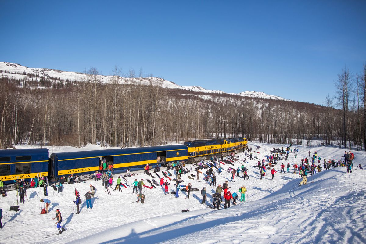 Skiers, snowshoers and snowboarders disembark the ski train at Curry on Saturday, Mar. 12, 2016. Hundreds of participants enjoyed above-freezing temperatures and deep snow. (LOREN HOLMES / Alaska Dispatch News)