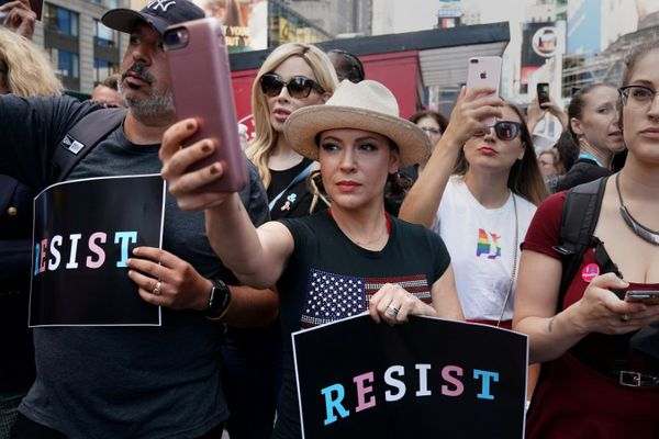 FILE PHOTO: Actress Alyssa Milano attends a protest in Times Square, New York City, New York, U.S., July 26, 2017. REUTERS/Carlo Allegri/File Photo