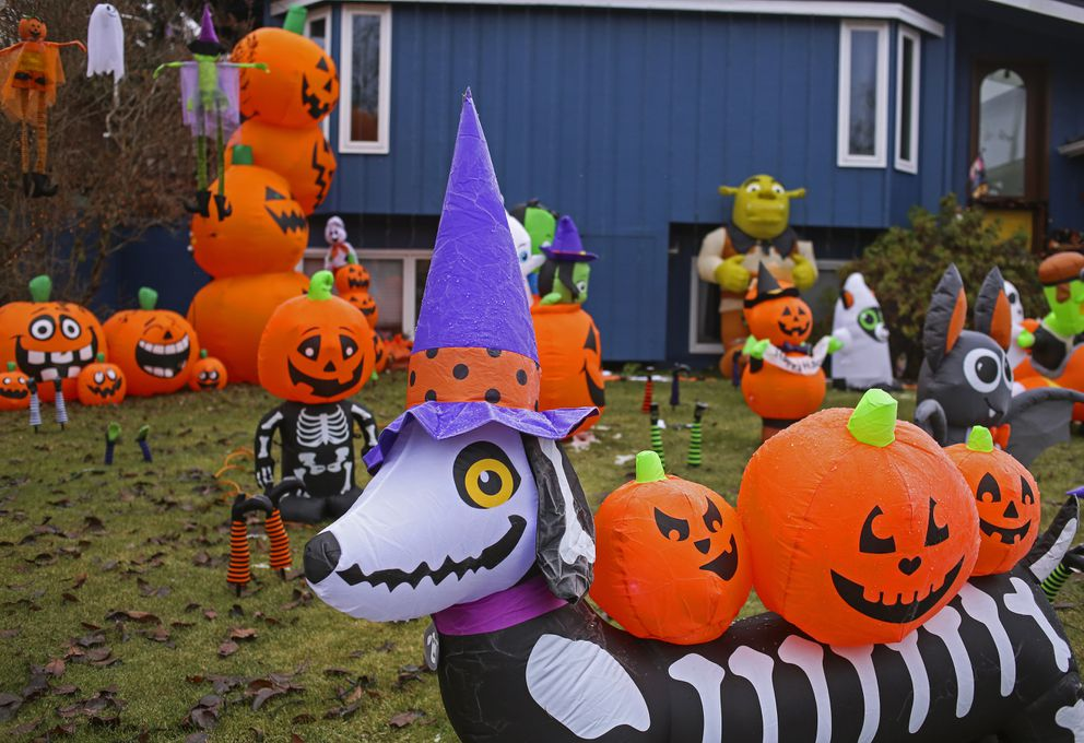 Halloween decorations cover the outside lawn of a home in a Turnagain neighborhood in Anchorage on Oct. 28, 2020. (Emily Mesner / ADN)