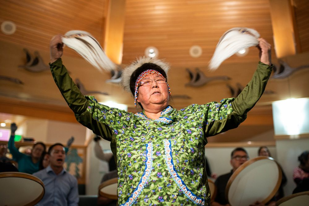 "Marie Sakar dances to the healing song ""Tarvarnauramken"" during a yuraq, or Yup'ik dance, at the Alaska Native Medical Center. She says she was inspired by her maternal grandmother, with whom she shares her English name, who also loved to dance. (Loren Holmes/Anchorage Daily News)"