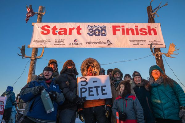 Peter Kaiser poses for a photo with supporters after winning his third straight Kuskokwim 300 sled dog race Sunday, Jan. 22, 2017, in Bethel. (Loren Holmes / Alaska Dispatch News)