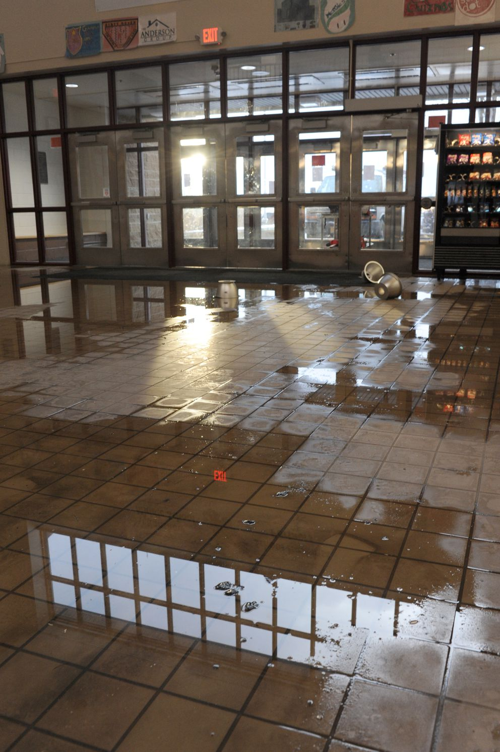 The entryway at Hanshew Middle School was heavily damaged by water and falling lights and other objects. (Anne Raup / ADN)