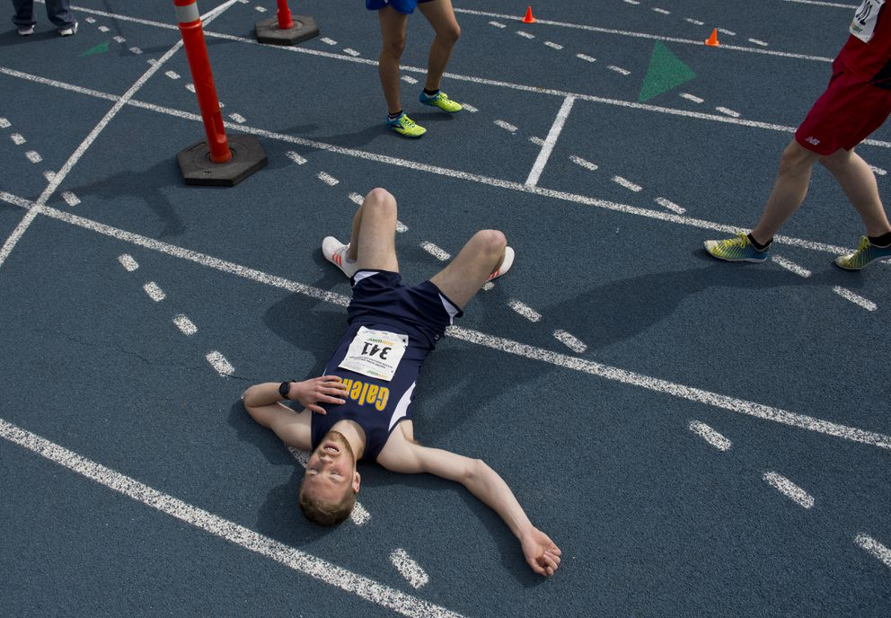 Jacob Moos of Galena catches his breath after winning the Division II boys 3,200 meters. (Marc Lester / ADN)