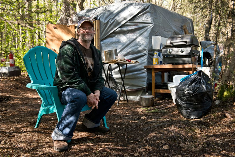 Matthew Strametz had been living in an insulated tent along the Chester Creek greenbelt with many modern conveniences, including solar panels, a gas oven, a space heater and electronic devices. Photographed on May 15. (Marc Lester / Alaska Dispatch News)