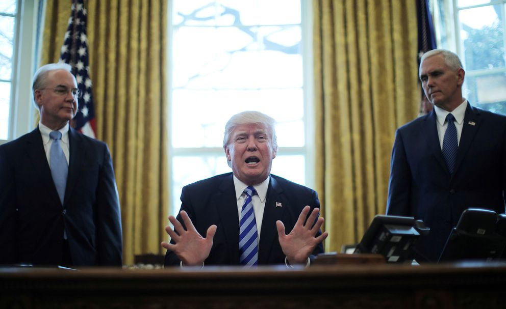 President Trump reacts Friday to the AHCA health care bill being pulled by congressional Republicans, with Secretary of Health and Human Services Tom Price (L) and Vice President Mike Pence in the Oval Office. REUTERS/Carlos Barria