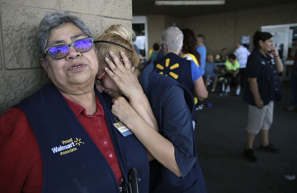 Walmart employees react after an active shooter opened fire at the store in El Paso, Texas, Saturday, Aug. 3, 2019. (Mark Lambie/The El Paso Times via AP)