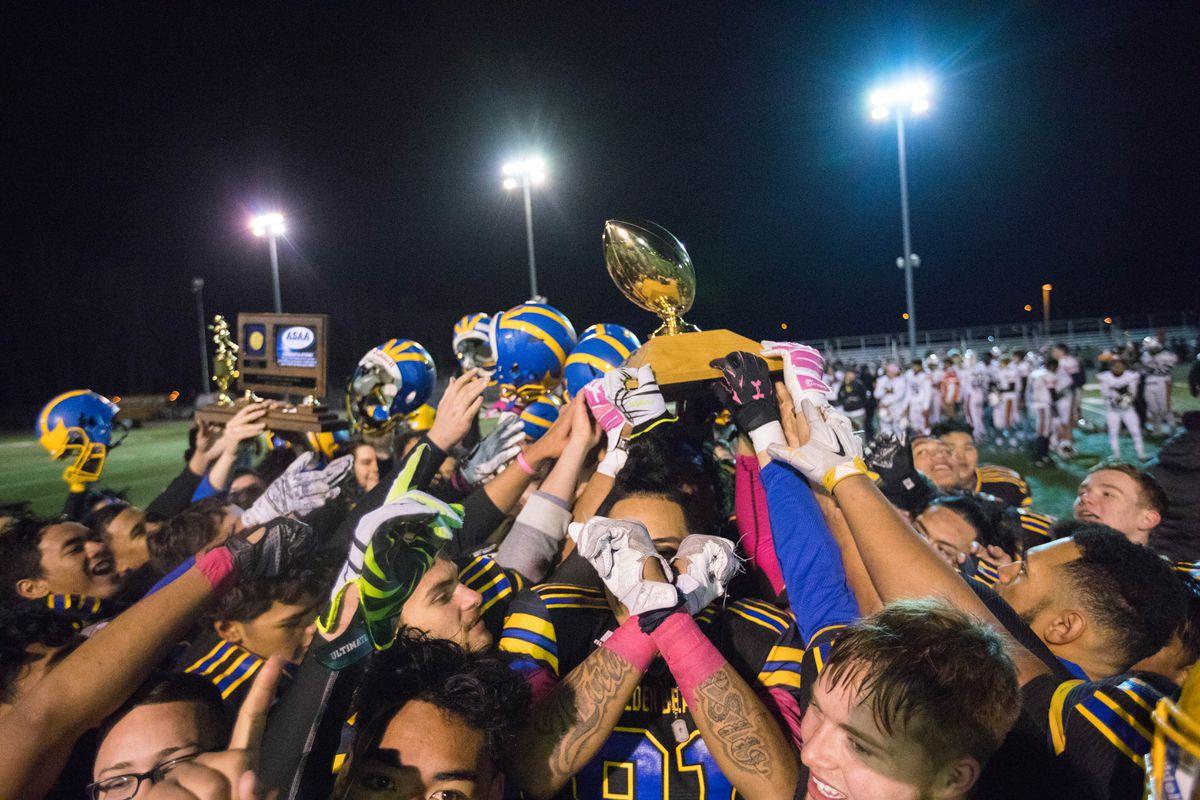 The Bartlett Golden Bears hoist the Alaska state football championship trophy after their 40-33 win over West Friday, Oct. 20, 2017. (Loren Holmes / Alaska Dispatch News)