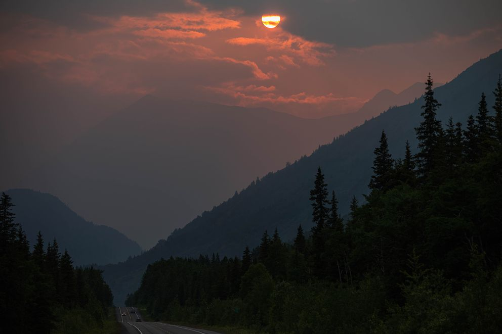 Smoke from the Swan Lake fire creates a vibrant sunset Wednesday night, June 19, 2019 in Moose Pass. (Loren Holmes / ADN)