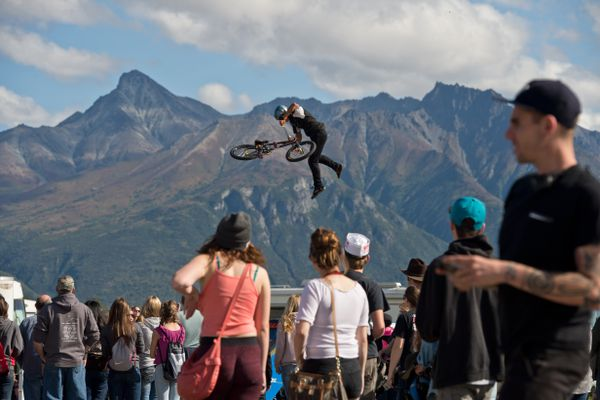 Cristhian Baron of King BMX performs aerial tricks Monday afternoon. Mostly sunny weather attracted large crowds to the Alaska State Fair on its final day, September 4, 2017. (Marc Lester / Alaska Dispatch News)