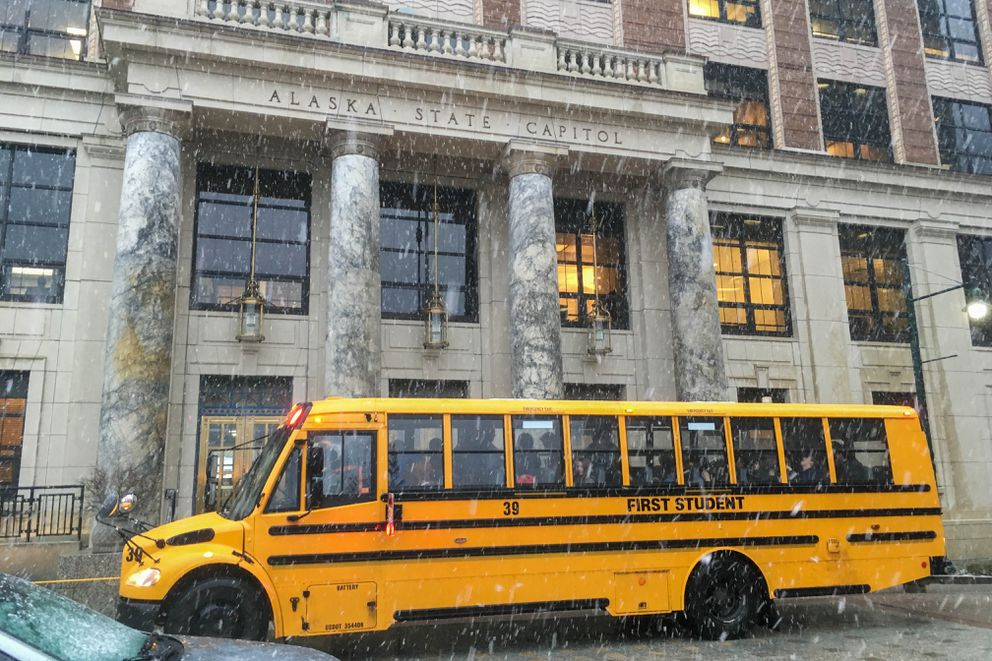 A school bus picks up kids after they toured the Alaska State Capitol on Tuesday, Jan. 29, 2019. (James Brooks / ADN)