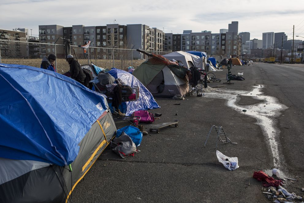 A homeless encampment near a new apartment complex in Denver, Jan. 2. (Nick Cote/The New York Times)