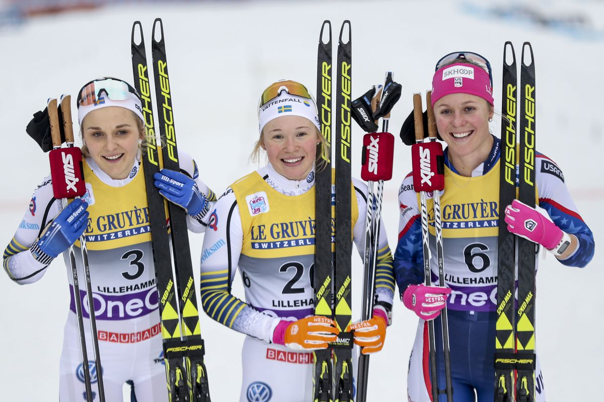 Sadie Bjornsen, right, joins winner Jonna Sundling, center, and second-place Stina Nilsson after placing third in Friday's World Cup freestyle sprint race in Norway. (Geir Olsen/NTB scanpix via AP)