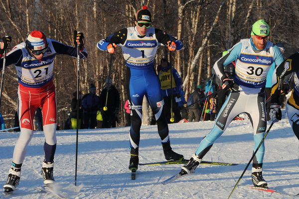 Logan Hanneman, center, skis in the quarterfinals of Friday's freestyle sprint race at Kincaid Park. (Bill Roth / ADN)