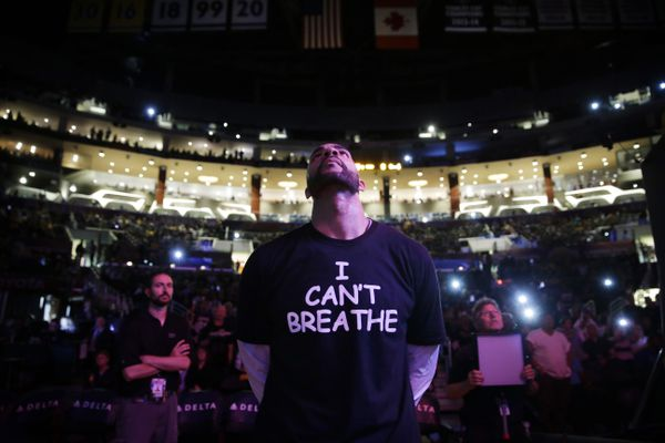 FILE - In this Dec. 9, 2014, file photo, Los Angeles Lakers' Carlos Boozer, wearing a T-shirt reading