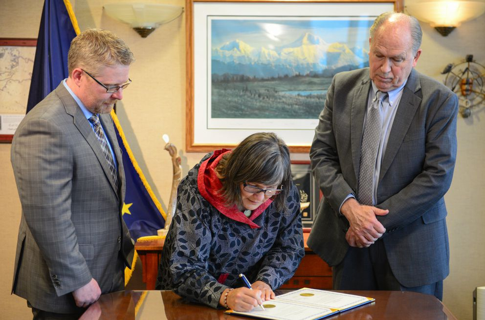 Chief of Staff Scott Kendall, left, Lt. Gov. Valerie Davidson, center, and Gov. Bill Walker, right, participate in the swearing-in ceremony, Oct. 16, 2018. (Office of Gov. Walker photo)