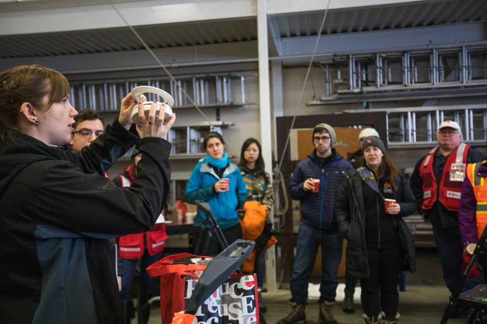 Celia Jackson, a disaster program manager with the American Red Cross, gives an orientation to volunteers at Fire Station 5 ahead of a home fire safety campaign on Martin Luther King Jr. Day. (Loren Holmes / Alaska Dispatch News)