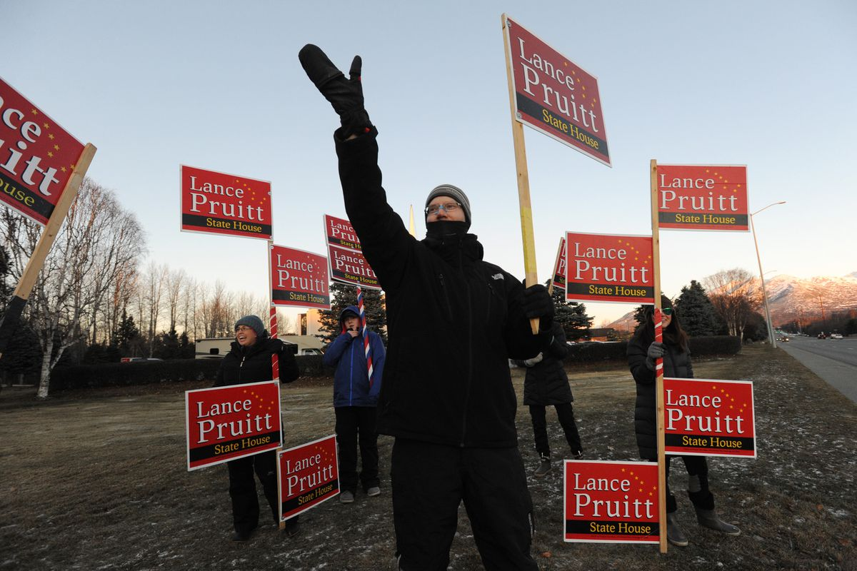 Republican incumbent Rep. Lance Pruitt waved to motorists as he campaigned on Election Day, Tuesday, Nov. 3, 2020. (Bill Roth / ADN)