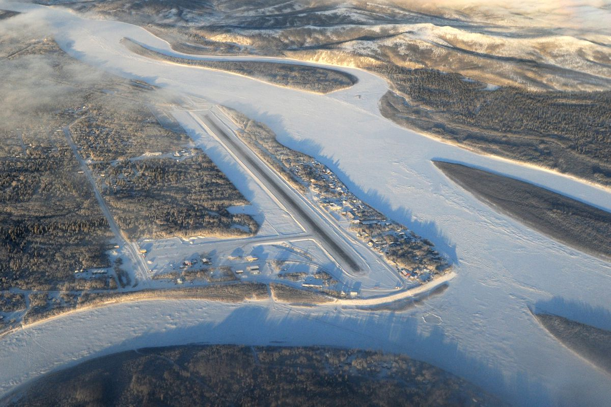 Aniak airport from the air on Jan. 12. Aniak Slough, lower left, and the Kuskokwim River, right, border the village of Aniak. (Bill Roth / ADN archive 2017)