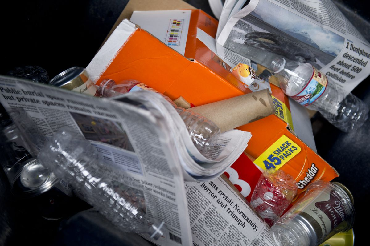 Michelle McCarten's household recycling cart contains a mix of newspapers, cardboard, plastic bottles and aluminum cans. Photographed on May 30, 2019. (Marc Lester / ADN)