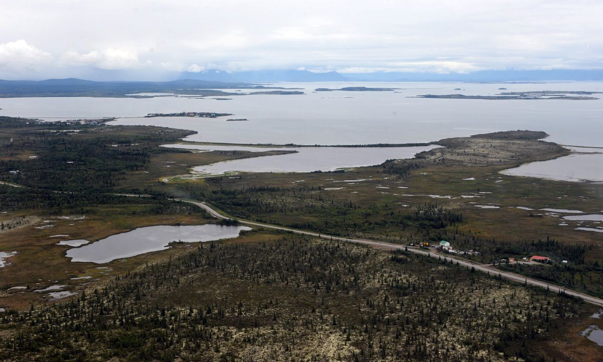 The village of Ilamna, Alaska is just a small cluster of buildings around crystal-clear Lake Iliamna, a nursery for wild salmon, which at 80 miles long is the largest U.S. freshwater lake outside the Great Lakes. (Bill Roth/Anchorage Daily News)