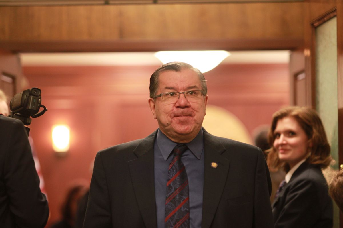 Bethel Democratic Sen. Lyman Hoffman, co-chair of the Senate Finance Committee, leaves the Senate chambers after a floor session Wednesday. (Nathaniel Herz / Alaska Dispatch News)