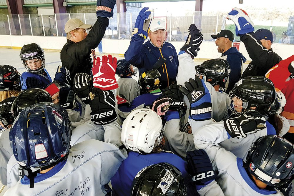 In this Oct. 13, 2018, photo retired NHL player Jim Campbell, center, sends campers off with a cheer during the Kodiak Alumni Youth Hockey Camp and Kodiak Cup Adult Tournament at the Baranof Park Ice Rink in Kodiak, Alaska. Nearly 90 campers ranging in age from elementary to high school soaked up all they could from the professionals during the three-day event that was created last year by Kodiak surgeon Russell DeGroote. Five NHL stars headlined the inaugural event. This year's showcase nearly tripled in size.(Derek Clarkston /Kodiak Daily Mirror via AP)