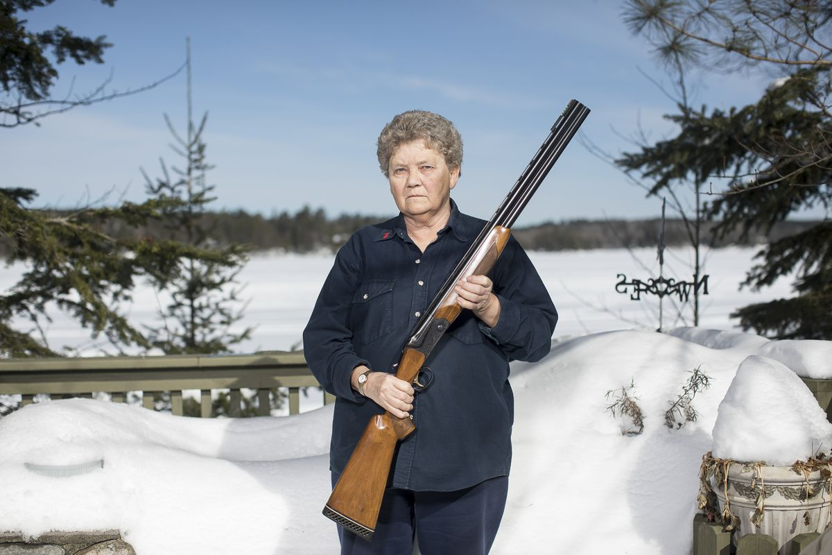 Judith Pearson, a retired school principal, with one of her shotguns at her home outside Cook, Minn., Feb. 27, 2018. (Tim Gruber/The New York Times)