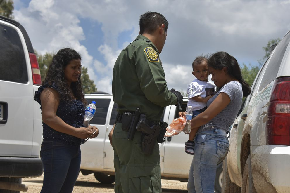 Two young mothers from Honduras and their children are detained by the United States Border Patrol in June 2018. (Washington Post photo by Jahi Chikwendiu)