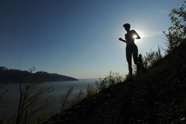 Competitors in the 8-mile Turnagain Arm Trail race top the hill out of McHugh Creek along the Turnagain Arm above the Seward Highway on Tuesday, May 12, 2015. (Bob Hallinen / ADN)