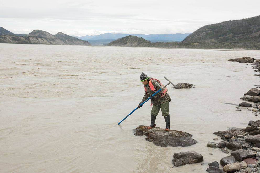 Anchorage resident Grace Rafael dipnets for salmon on the Copper River south of Chitina on June 29, 2017. (Loren Holmes / Alaska Dispatch News)