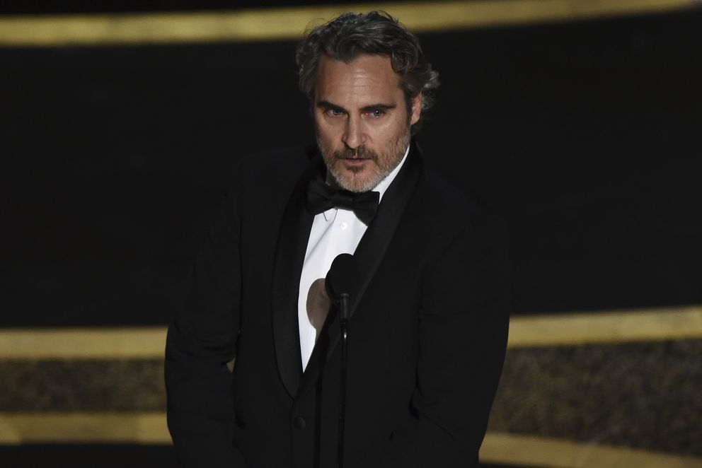Joaquin Phoenix accepts the award for best performance by an actor in a leading role for 'Joker ' at the Oscars on Sunday, Feb. 9, 2020, at the Dolby Theatre in Los Angeles. (AP Photo/Chris Pizzello)