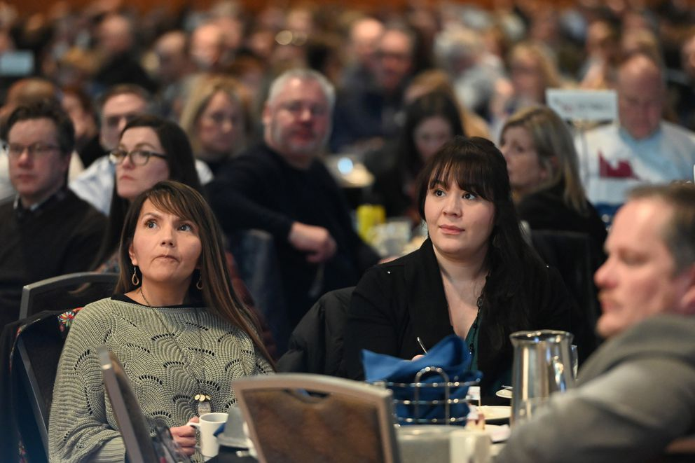 People listen to AEDC president and CEO Bill Popp as he presented the 1-year economic forecast for Anchorage during a sold-out luncheon, more than 1,500 people, in the Dena'ina Center on Wednesday. (Bill Roth / ADN)