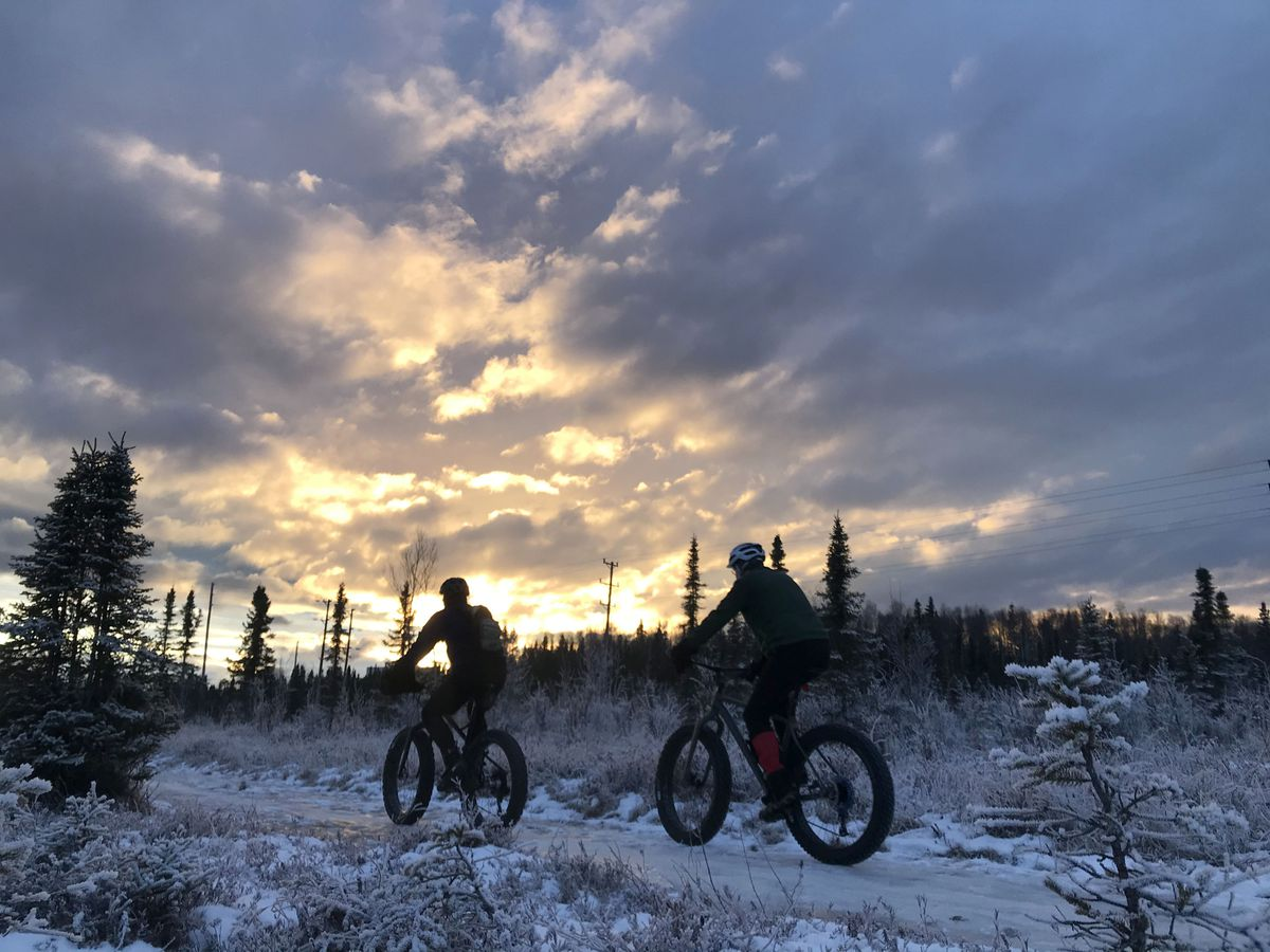 Fat bikers travel across frozen swamp in East Anchorage, Dec. 15, 2019. (Anne Raup / ADN)