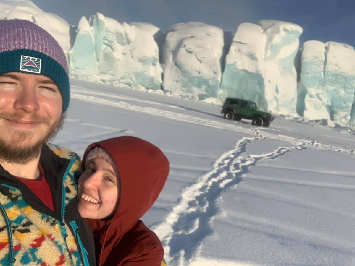 Josh Tills and his girlfriend Taylor Wilson smile for a photo at the Knik Glacier on Sunday, Jan. 26, 2020. Shortly after taking this photo, Tills' Jeep partially sank. (Photo by Josh Tills)