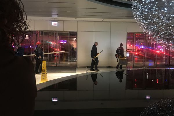 Chicago fire crews rescued six people who had been trapped in an elevator early Friday morning, Nov. 16, in a downtown Chicago skyscraper formerly called the John Hancock Center. (Hanna Leone/Chicago Tribune/TNS)