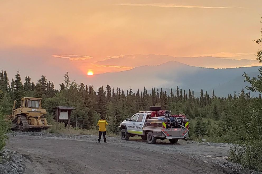 A Nikiski Fire brush truck works closely with a bulldozer putting in a contingency line near the Swan Lake Fire, June 23, 2019. (Photo by Kassidy Stock / Nikiski Fire)