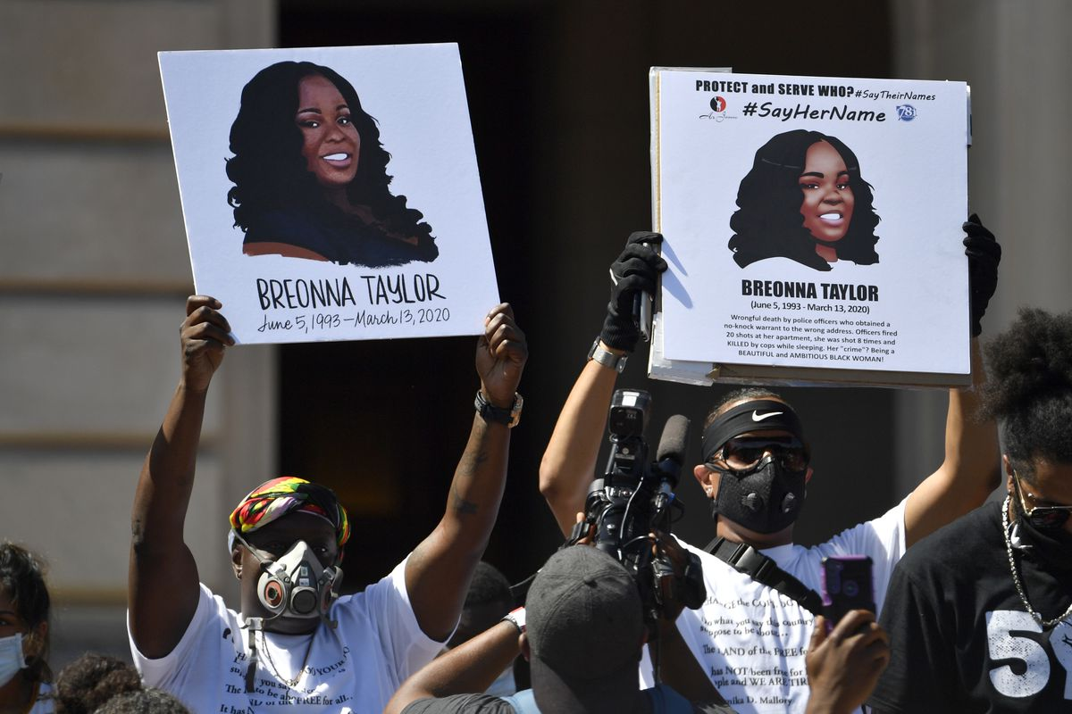 FILE - Signs are held up showing Breonna Taylor during a rally in her honor on the steps of the Kentucky State Capitol in Frankfort, Ky., Thursday, June 25, 2020. (AP Photo/Timothy D. Easley, File)
