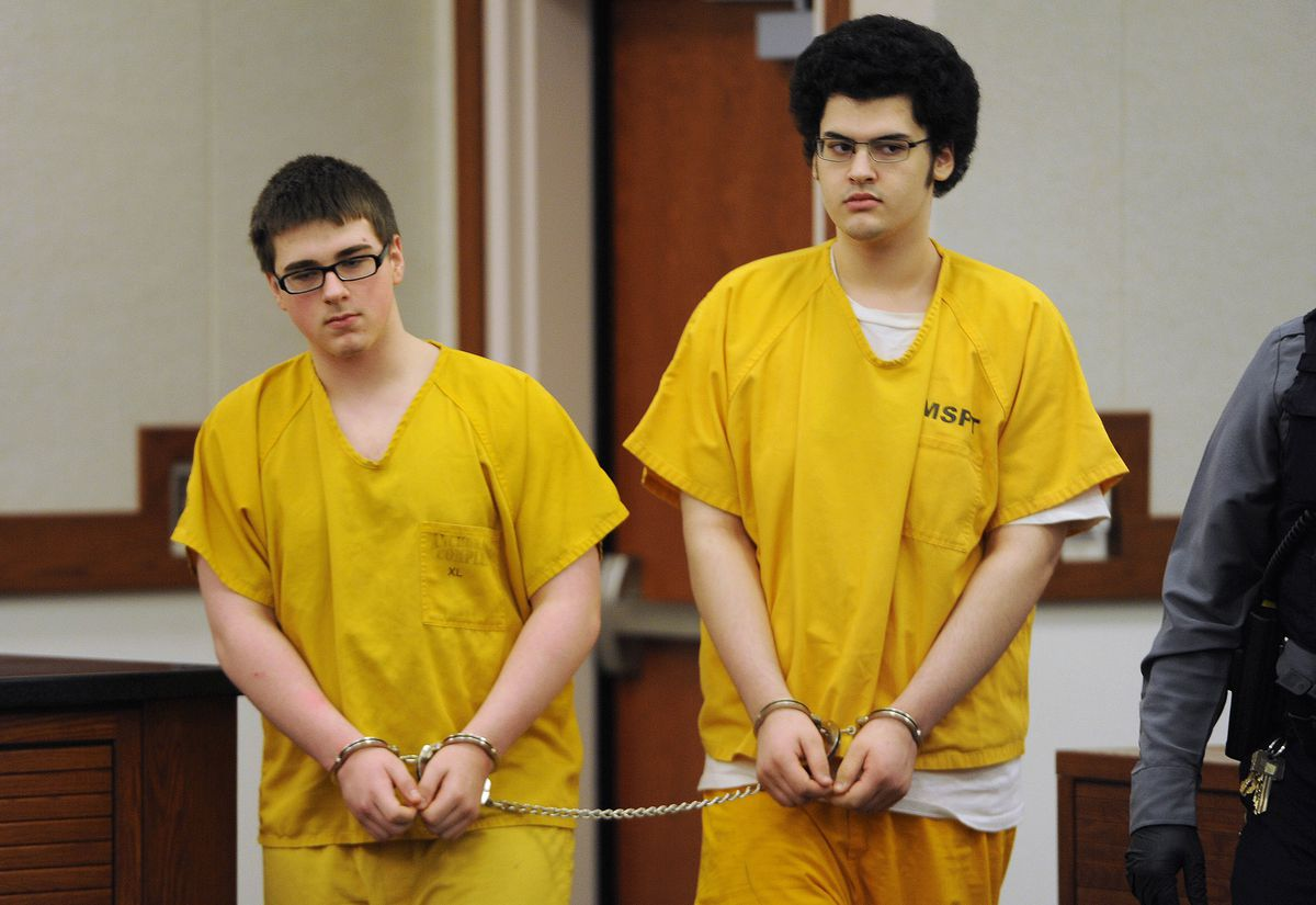 Defendants Bradley Renfro, left, and Dominic Johnson, two of four men charged with the murder of David Grunwald in Nov. 2016, leave a Palmer courtroom after attending a hearing on Tuesday, Dec. 19, 2017. (Bill Roth / ADN)