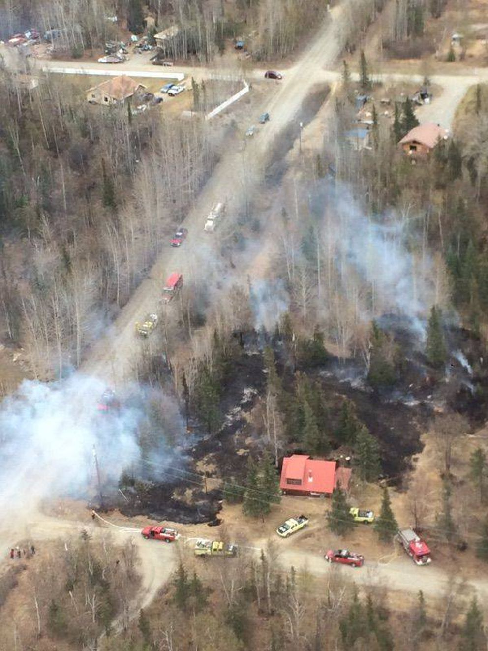 Fire officials say a 1-acre wildfire on Teresa Drive outside Palmer, on Saturday, May 6,2017, began when a charcoal grill overturned in high winds. (From Alaska Division of Forestry)