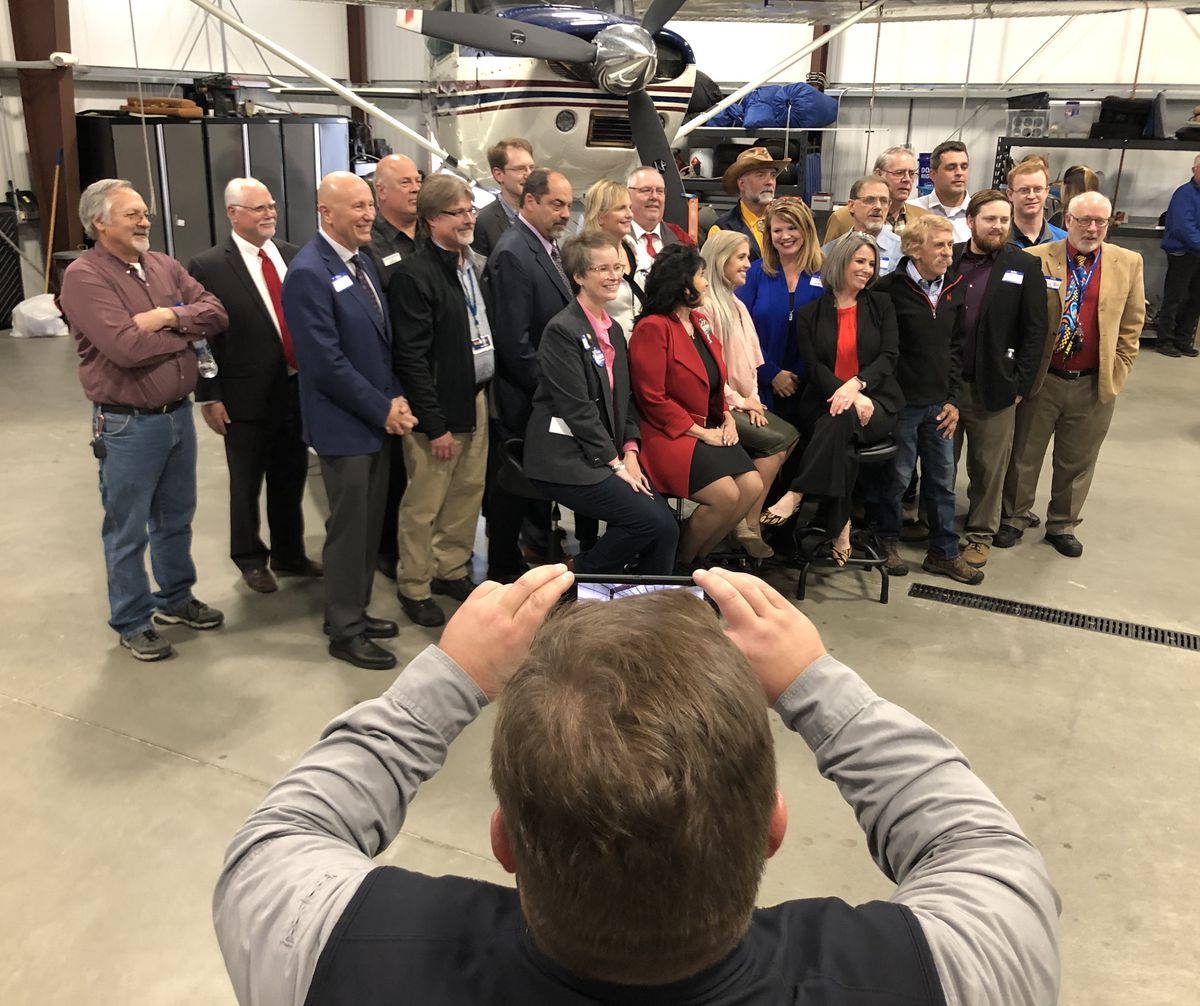 Heath Hilyard, chief of staff to Rep. Cathy Tilton, R-Wasilla, takes a picture of Republican candidates for the Alaska House of Representatives during a fundraiser Wednesday, Sept. 30, 2020 in a hangar at Lake Hood Seaplane Base. The event took place one day before President Trump's coronavirus infection was publicized. Other events have continued since then. (James Brooks / ADN)