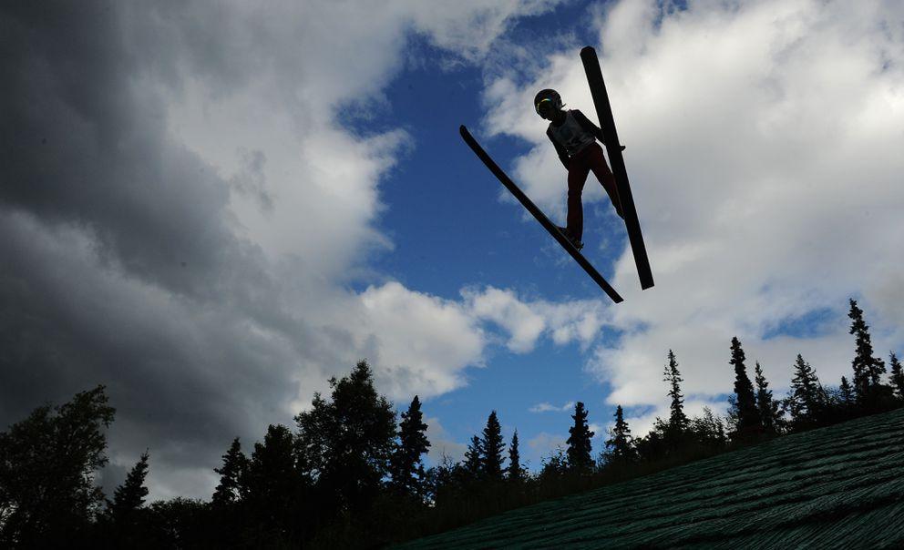 Dylan Amy flies off the 40-meter hill. (Bob Hallinen / ADN)