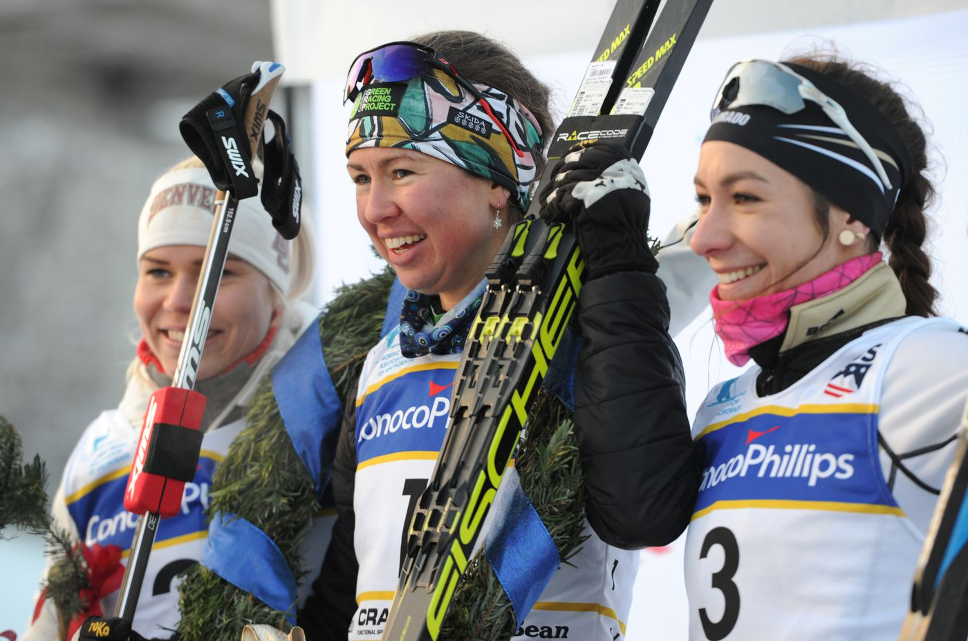 Freestyle sprint winner Caitlin Patterson is flanked by runner up Jasmi Joensuu, left, and Petra Hyncicova, right on the podium during the U.S. Cross Country Skiing Championships at Kincaid Park on Friday, Jan. 5, 2018. (Bill Roth / ADN)