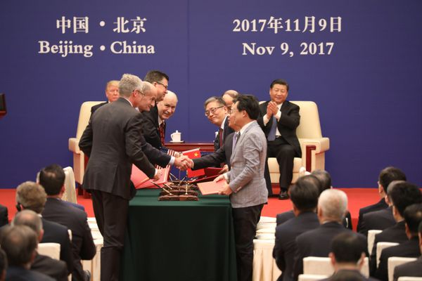 Gov. Bill Walker, center, smiles after the signing of the Joint Development Agreement for an Alaska gas line in Beijing on Nov. 9. (Photo provided by Office of the Governor)