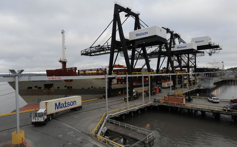 Containers are off-loaded from cargo ships at the Port of Anchorage last year. (Bill Roth / Alaska Dispatch News)