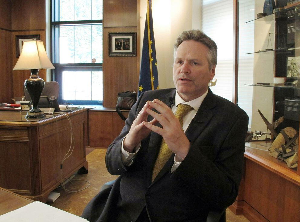 In this May 29, 2019 file photo, Alaska Gov. Mike Dunleavy speaks to reporters in his office at the state Capitol in Juneau, Alaska. Dunleavy said he hopes to move past the rancor of his first year in office, amid an unsettled dispute with lawmakers over state spending and threat of a recall effort looming large. (AP Photo/Becky Bohrer, File)
