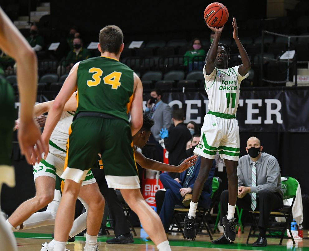 Bentiu Panoam launches a 3-point shot shot in a January 2021 game against North Dakota State. (Photo by Russ Hons / FightingHawks.com)