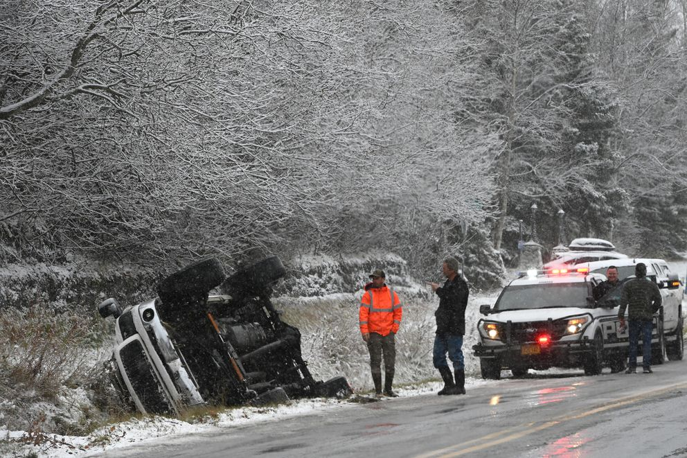 Anchorage police responded to a vehicle in the ditch along Birch Road during the first snow in Anchorage on Sunday, Oct. 18, 2020. (Bill Roth / ADN)