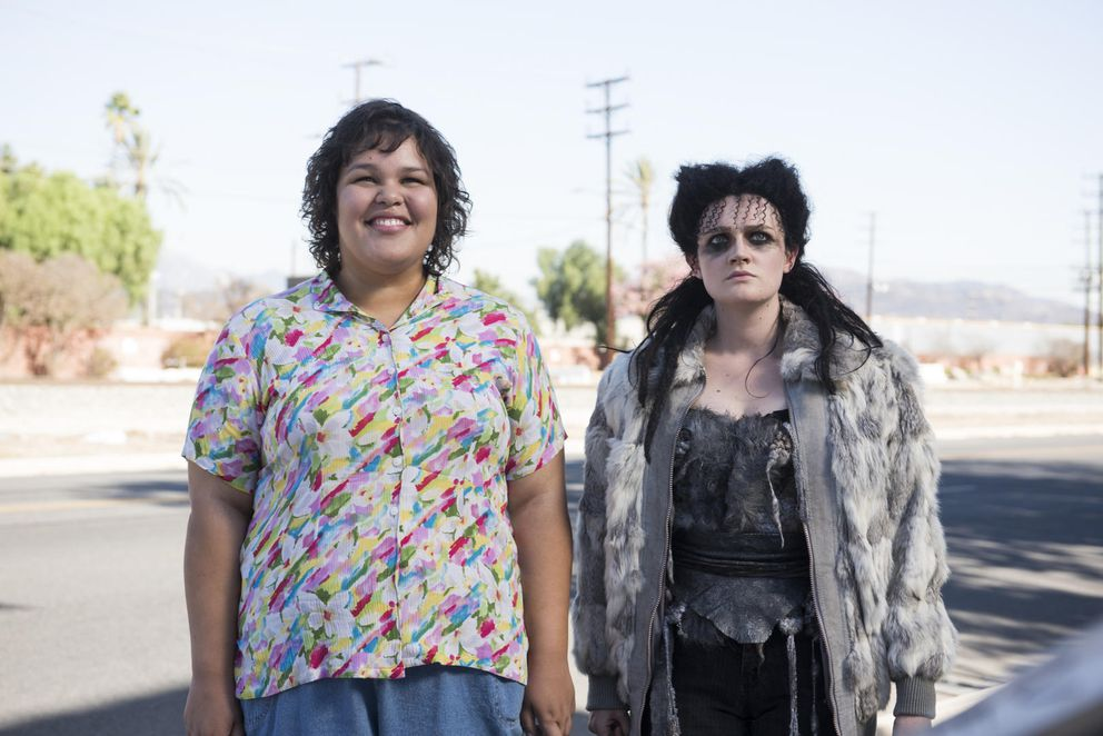 "Chugiak High School alum Britney Young, left, plays Carmen Wade and Gayle Rankin plays Sheila the She-Wolf in the Netflix series ""GLOW."" (Erica Parise / Netflix)"