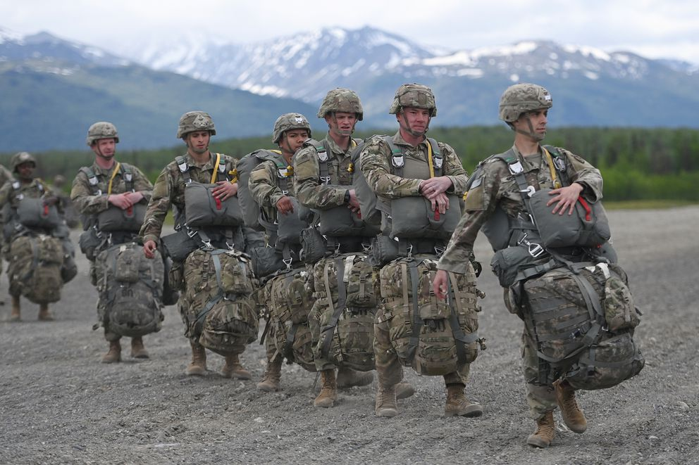 Paratroopers from the 4th Infantry Brigade Combat Team (Airborne), 25th Infantry Division, walk towards a CH-47 Chinook helicopter during airborne operations on Tuesday. (Bill Roth / ADN)